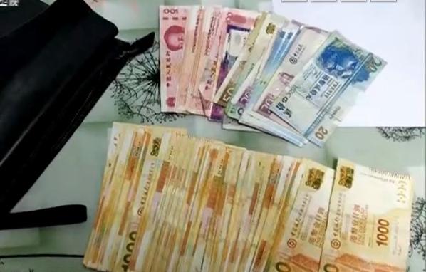 广州:地铁拾获手提包 十万现金惊呆站务员