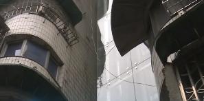 """广州:旧楼装上""""观光电梯"""""""