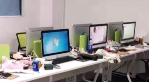 深圳:寫字樓藏詐騙窩點 擺放近百部手機