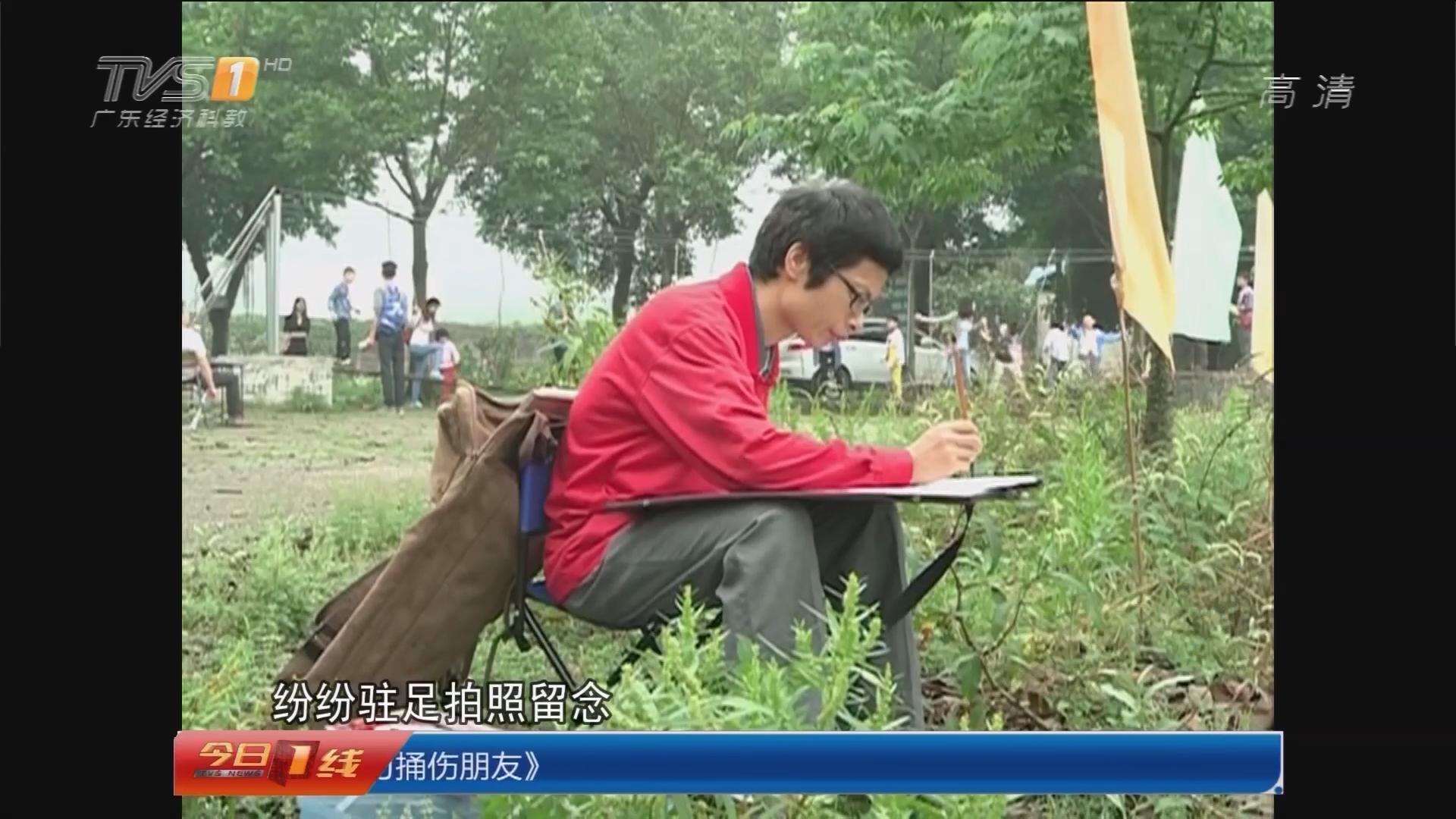 五一游园 肇庆:花团锦簇吸引游客写生