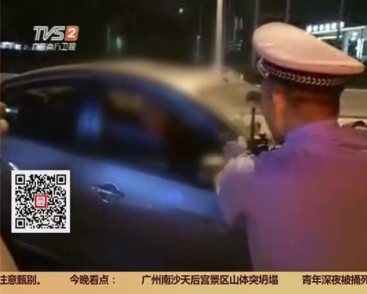 广州白云区广花路:男子持刀劫车 90后车主冷静应对