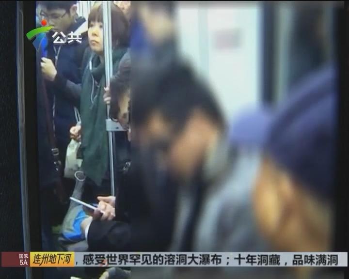 广州:老人早高峰坐地铁 遭年轻男人打骂
