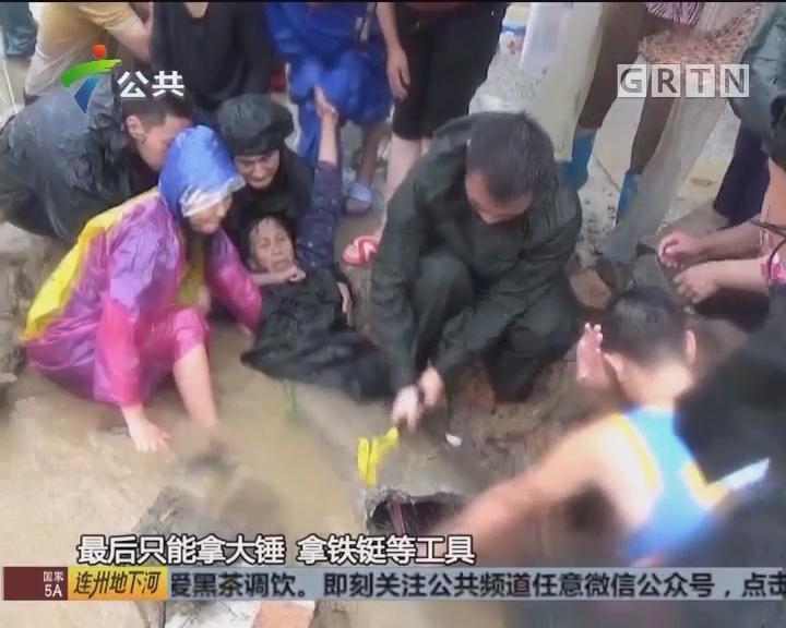 老人雨中被卡排水口 街坊消防合力救援
