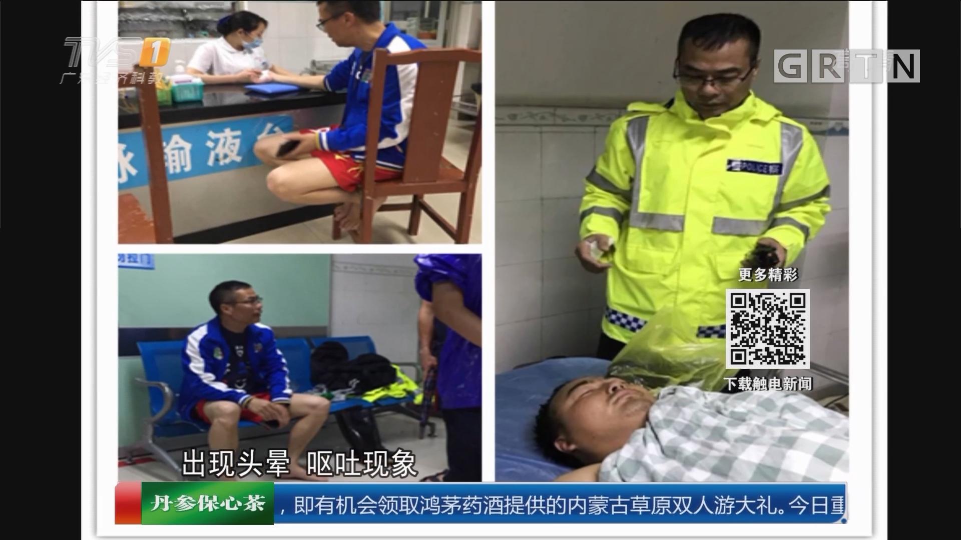 广州增城:排水员暴雨中晕倒 交警紧急相救