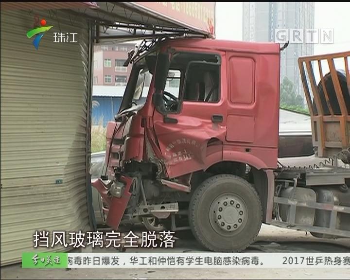 广州:挂车失控撞上店铺 幸无人员伤亡