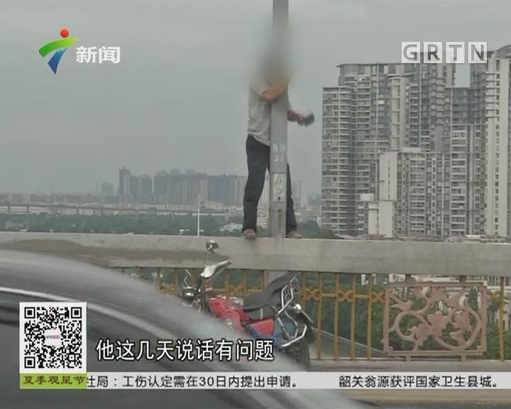 广州番禺洛溪大桥:持刀男子欲跳桥 引现场大塞车