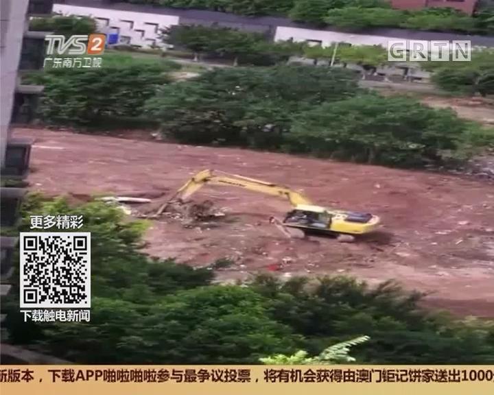 广州白云区金沙洲:荒地紧挨居民楼 货车前来填垃圾?
