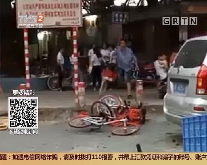 广州天河:男子疯狂抛砸共享单车 10辆车遭殃