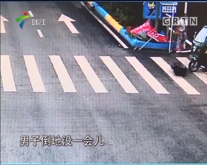 闯红灯被撞飞 甩到路牌捡回命