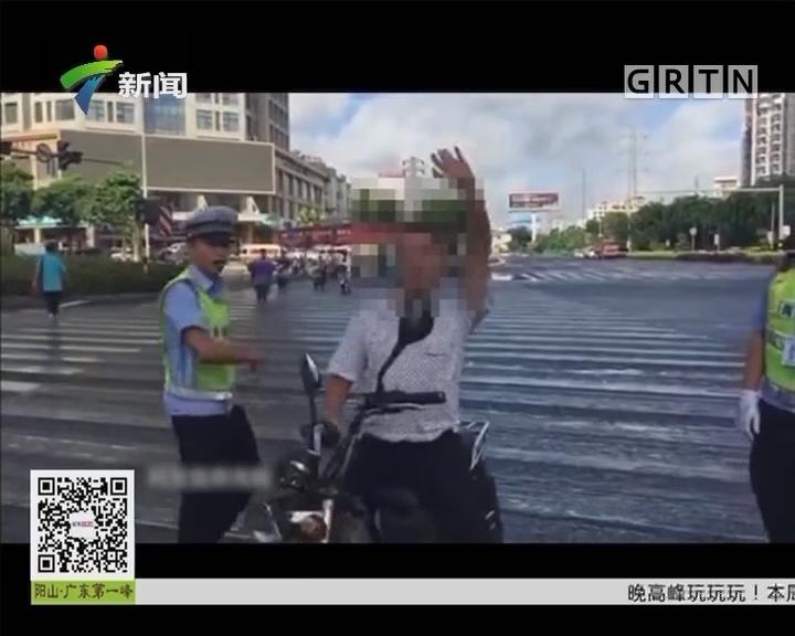 神奇一幕:男子交通违规 斑马线上尬舞