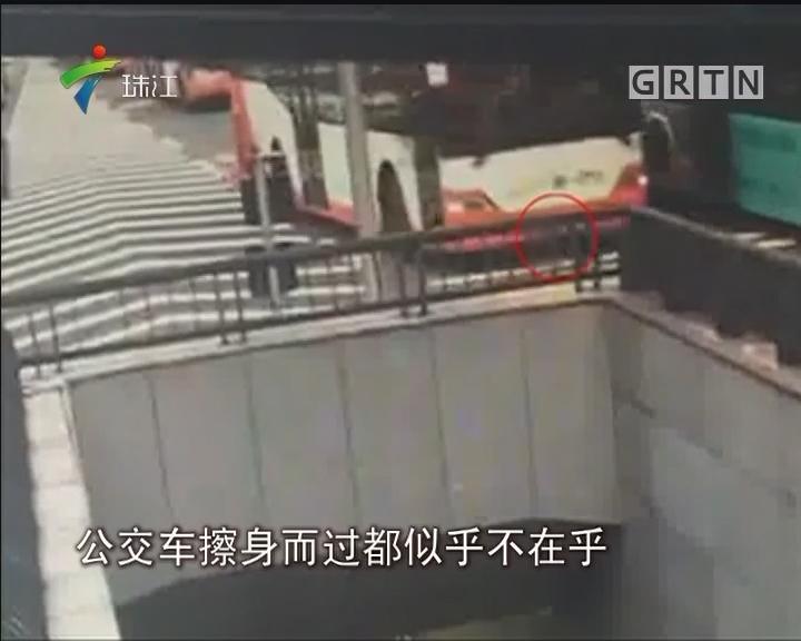 广州:七岁女童车道乱窜 司机乘客伸援手