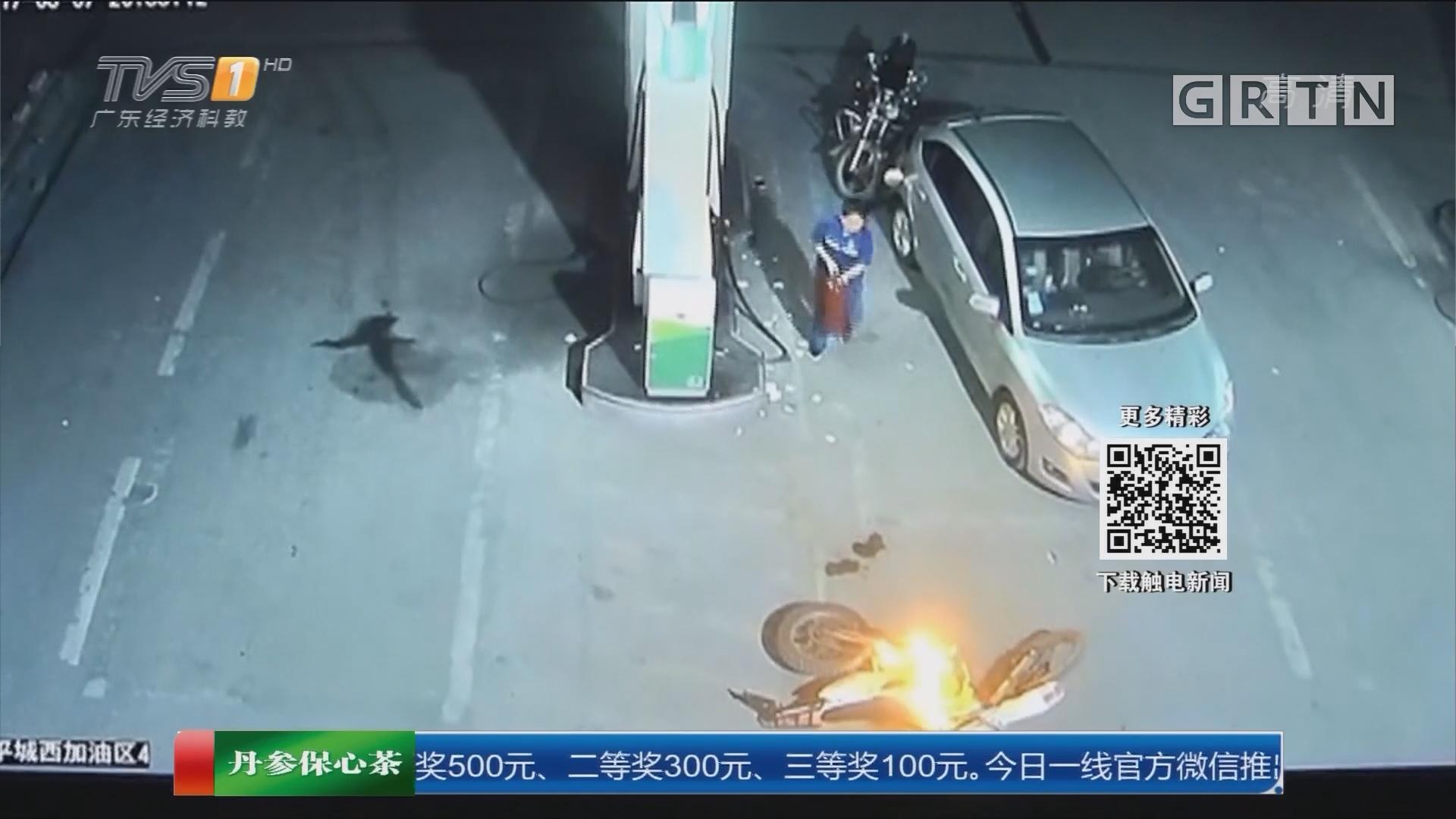 江西:加油站内车起火 女员工果断处置