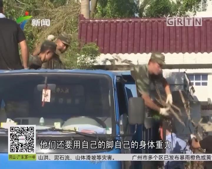 """珠海:众志成城救灾复产 新闻特写:兵哥哥的""""花腿"""""""