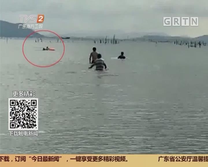 珠海大飞沙滩:一家四口出海翻船 众街坊合力施救