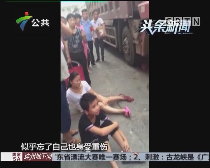 女童冲出马路被撞 母亲以身相救受伤