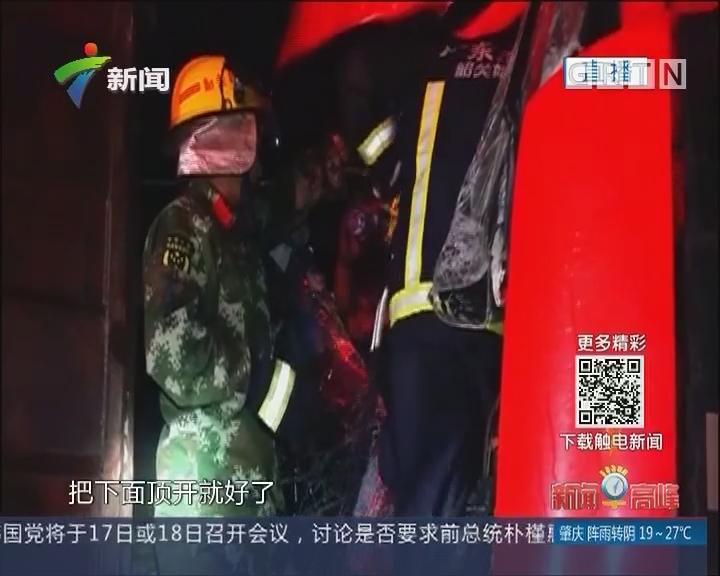 韶关:雨天路滑货车相撞 消防救出受困者