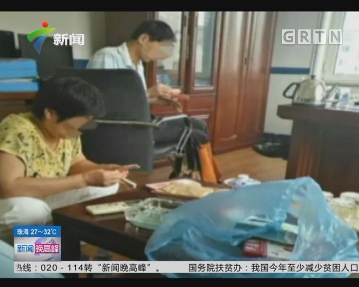 辽宁大连:装修房子发现巨款 工人欲取业主阻拦