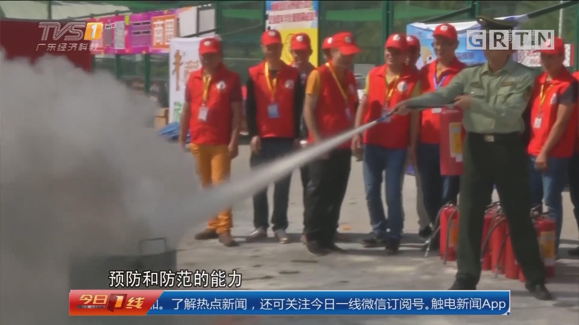 关注消防安全:广州 救火英雄亲上阵 教街坊防火