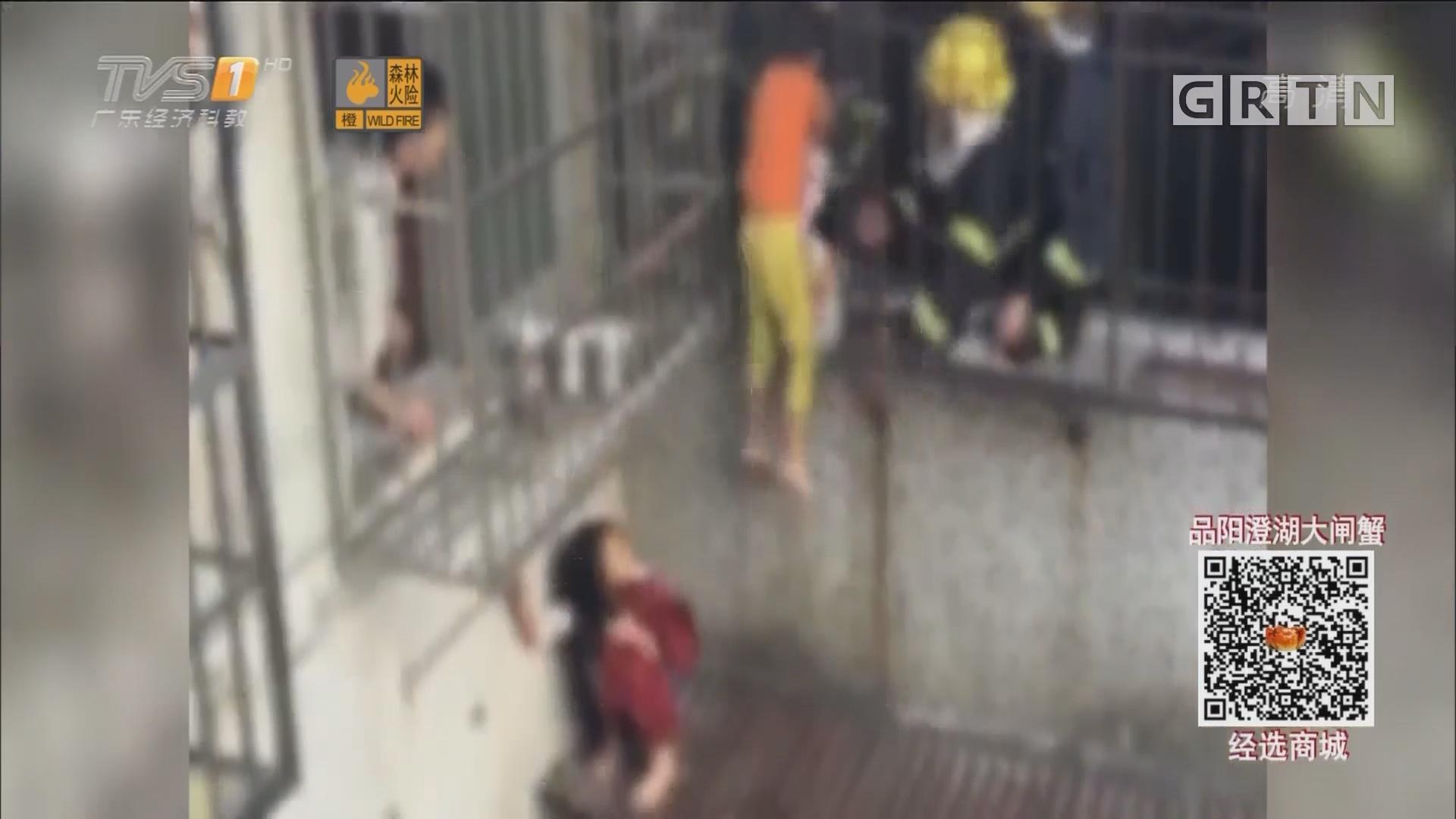 广州:小女孩临危不乱 火场勇救弟弟