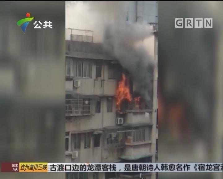广州:民宅发生火灾 隔壁楼保安自发救火