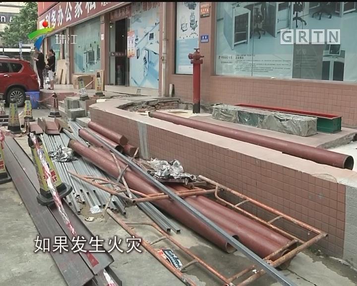 番禺:过道加装手扶梯建商铺 居民忧心消防安全