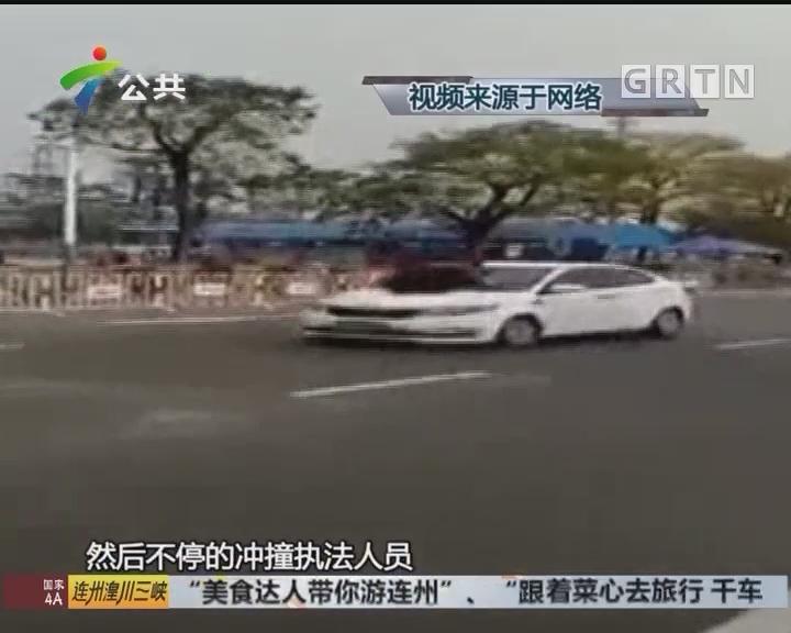 中山:执法人员趴在车头 汽车仍疯狂行驶