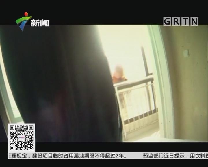 江苏南通:女子站在八楼窗外险象环生