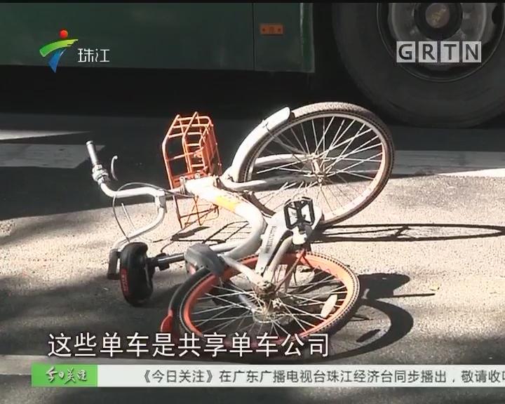 广州:公交车路中间停站 单车阻塞之过?