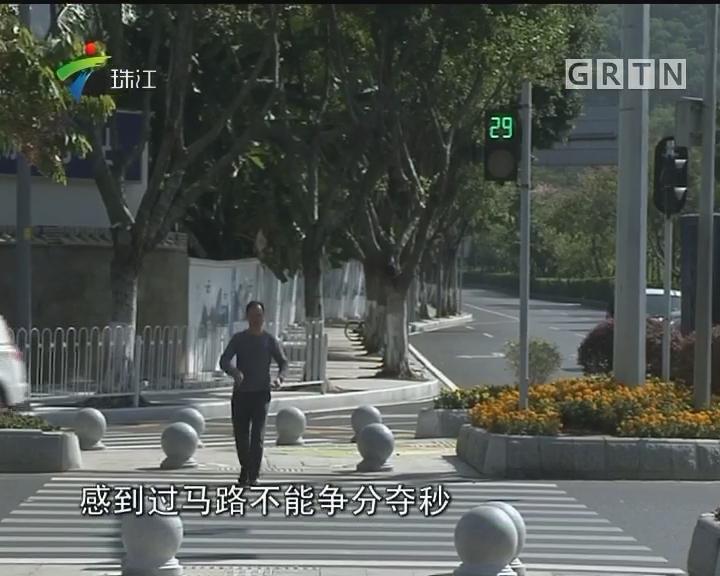 广州:趣味图案等候区提醒市民文明出行