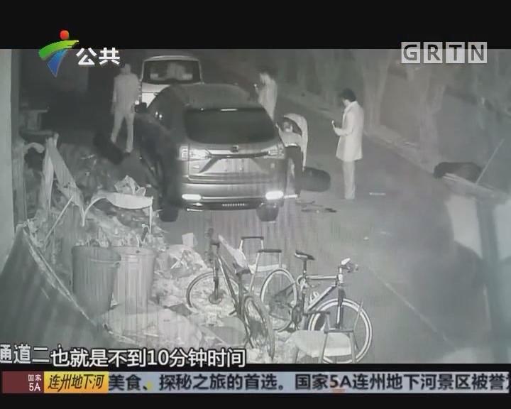 深圳:缺轮小车停厂内 众人装胎开走