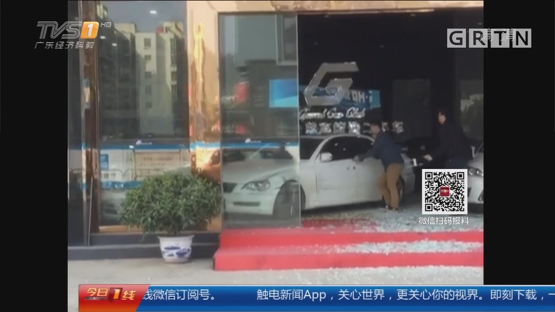 惠州惠城:开车疯狂撞进车行 司机被拘