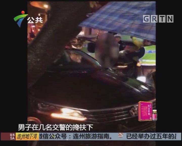 广州:男子酒醉驾驶 交警到场仍熟睡