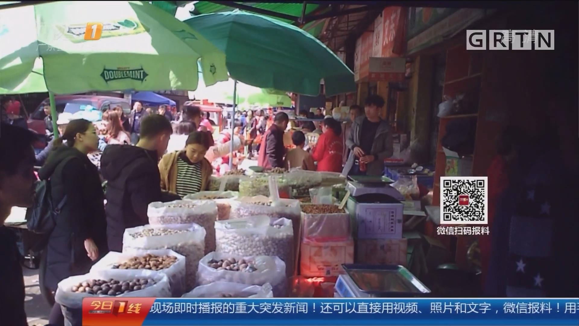 一线调查:年货里的秘密 街坊市场买年货 回来发现短斤少两