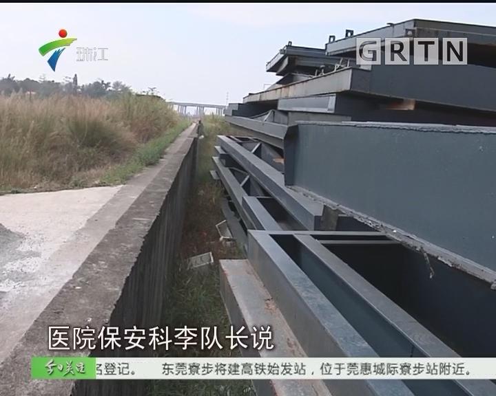 东莞:防洪堤坝堆钢材影响安全 水务局责令清理