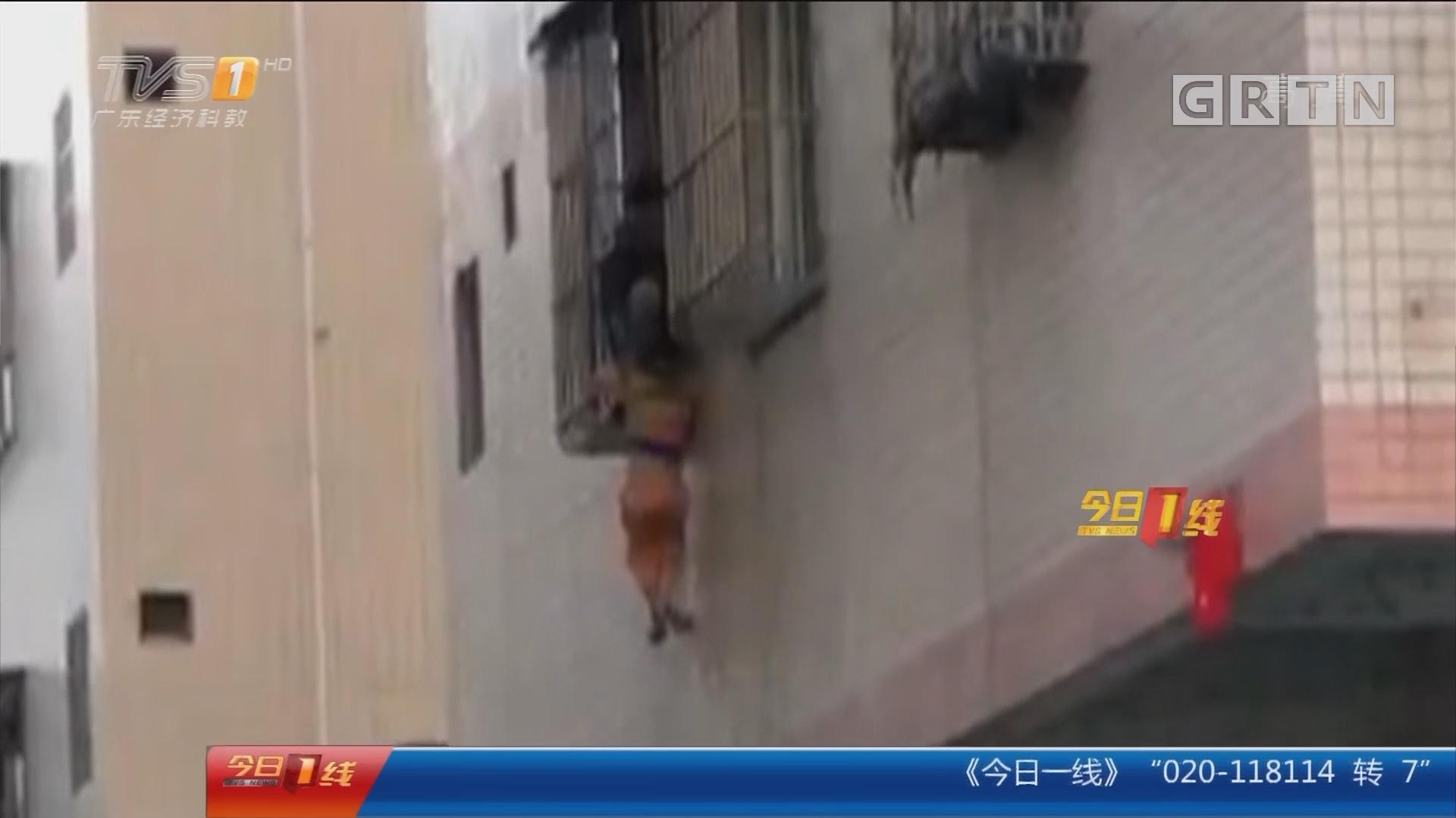 佛山南海大沥:男童头卡防盗网 众街坊暖心施救