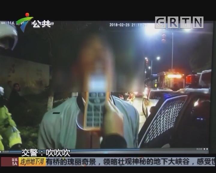 深圳:醉酒司机路中酣睡 佯装没有开车