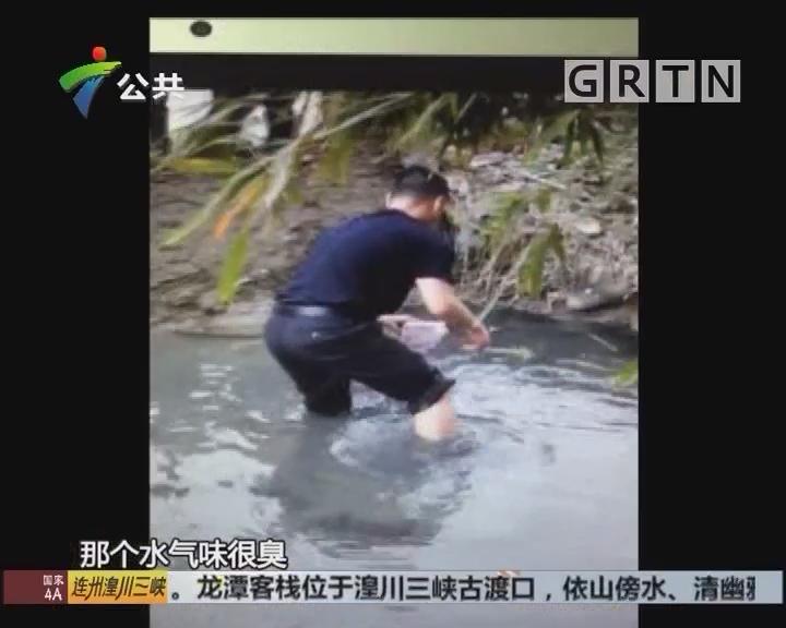 中山:围堤边车辆翻侧 民警下水捡钱交还伤者