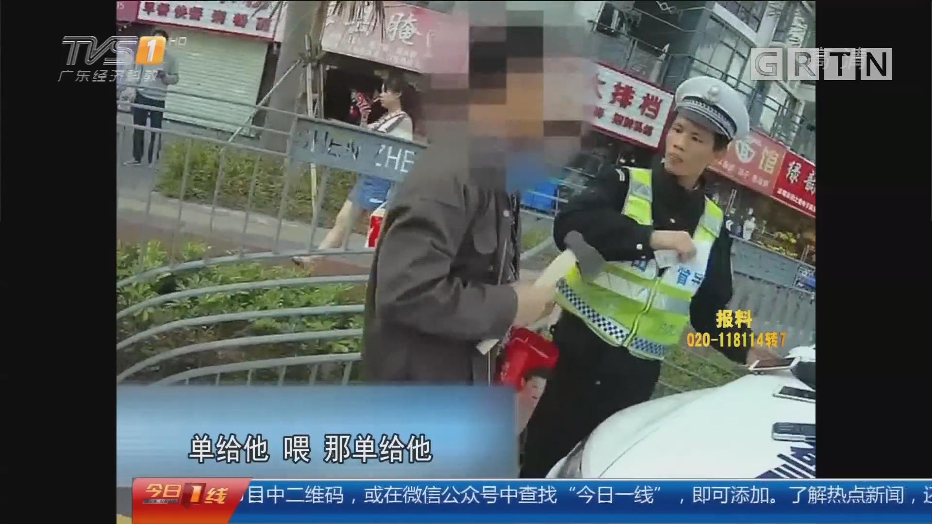 """深圳:男子挥斧头对交警""""叫嚣"""" 被拘留10天"""
