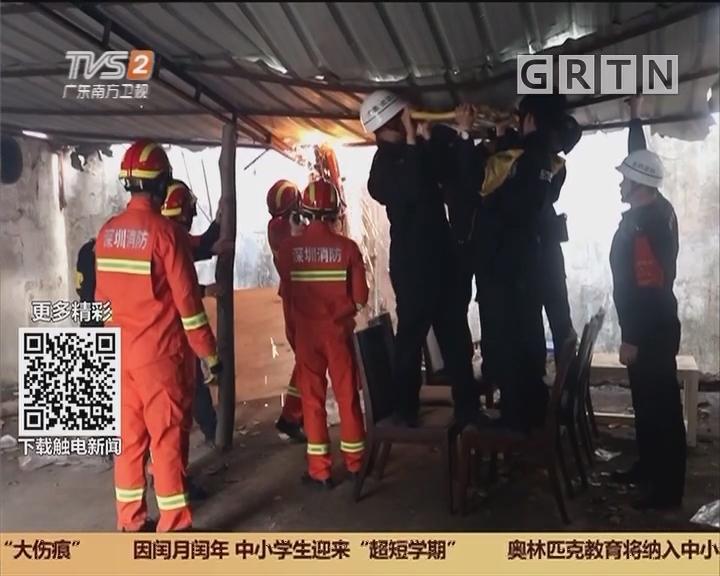 深圳:女子跳楼悬于铁皮上 消防员托举救人