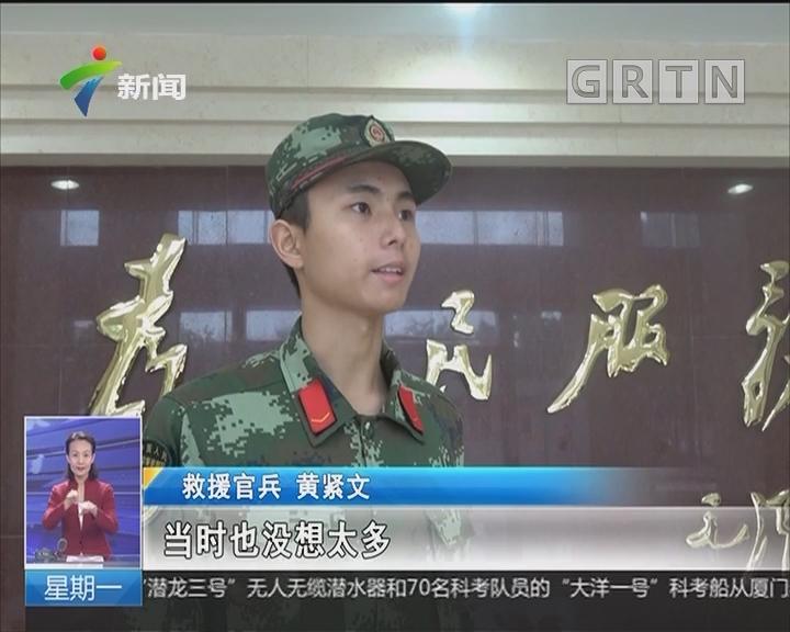 中山:货车雨天侧翻 边检官兵火速救人