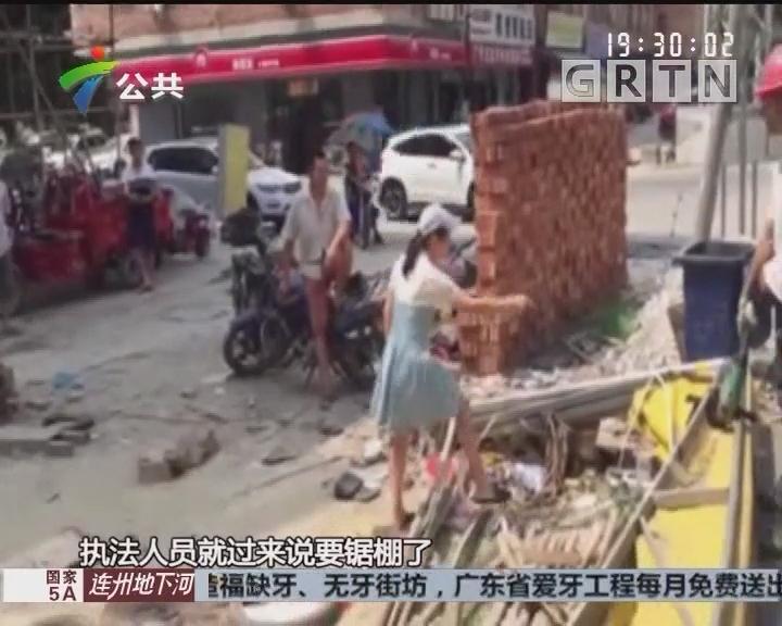 广州:城管执法锯钢管 店主奋力阻挠