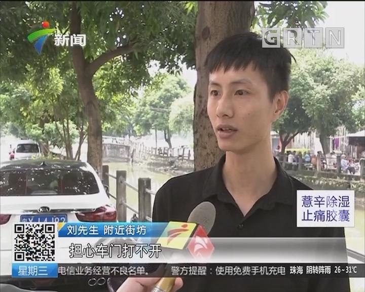 佛山南海:出租车连人带车冲入河 村民合力营救