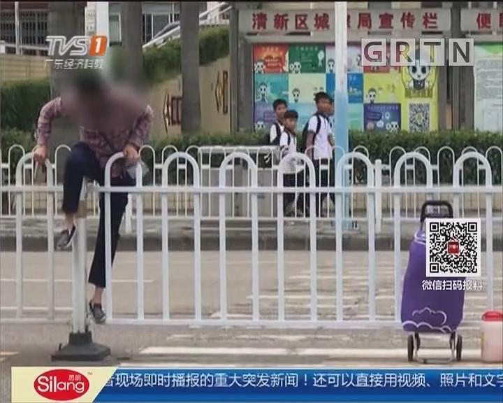 清远:行人冒险跨护栏 莫贪方便安全第一!