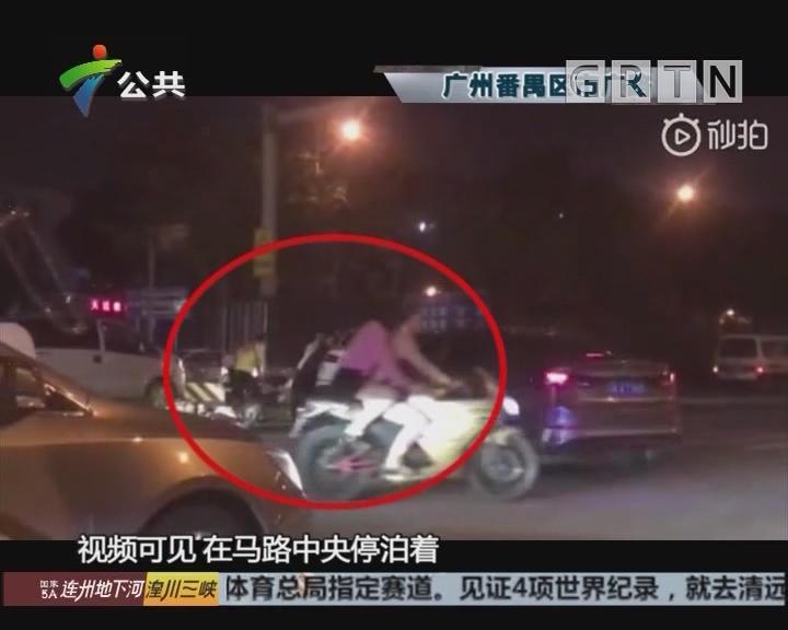 电瓶车司机被压轿车底 路过市民抬车救人
