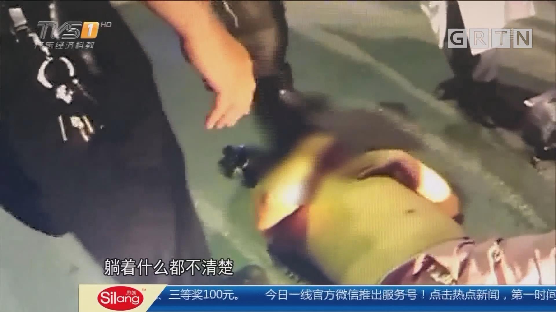 深圳龙岗:醉汉半裸卧马路 获热心人停车相护