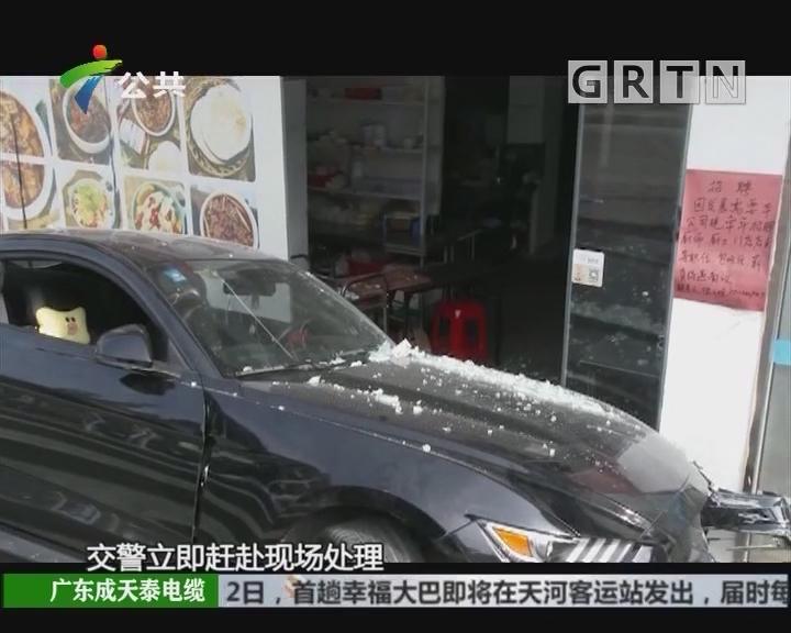 深圳:小车冲上人行道 司机疑似酒驾被拘