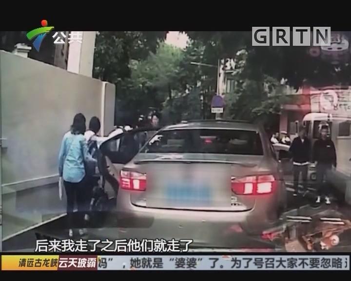 广州:小车突然开门 撞倒一名女学生