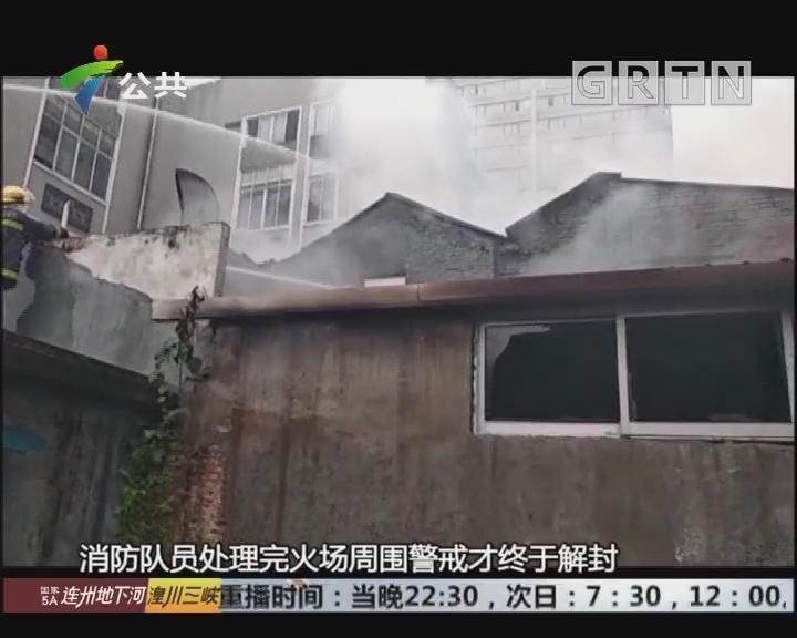 广州:砖木结构骑楼着火 消防砸窗救人