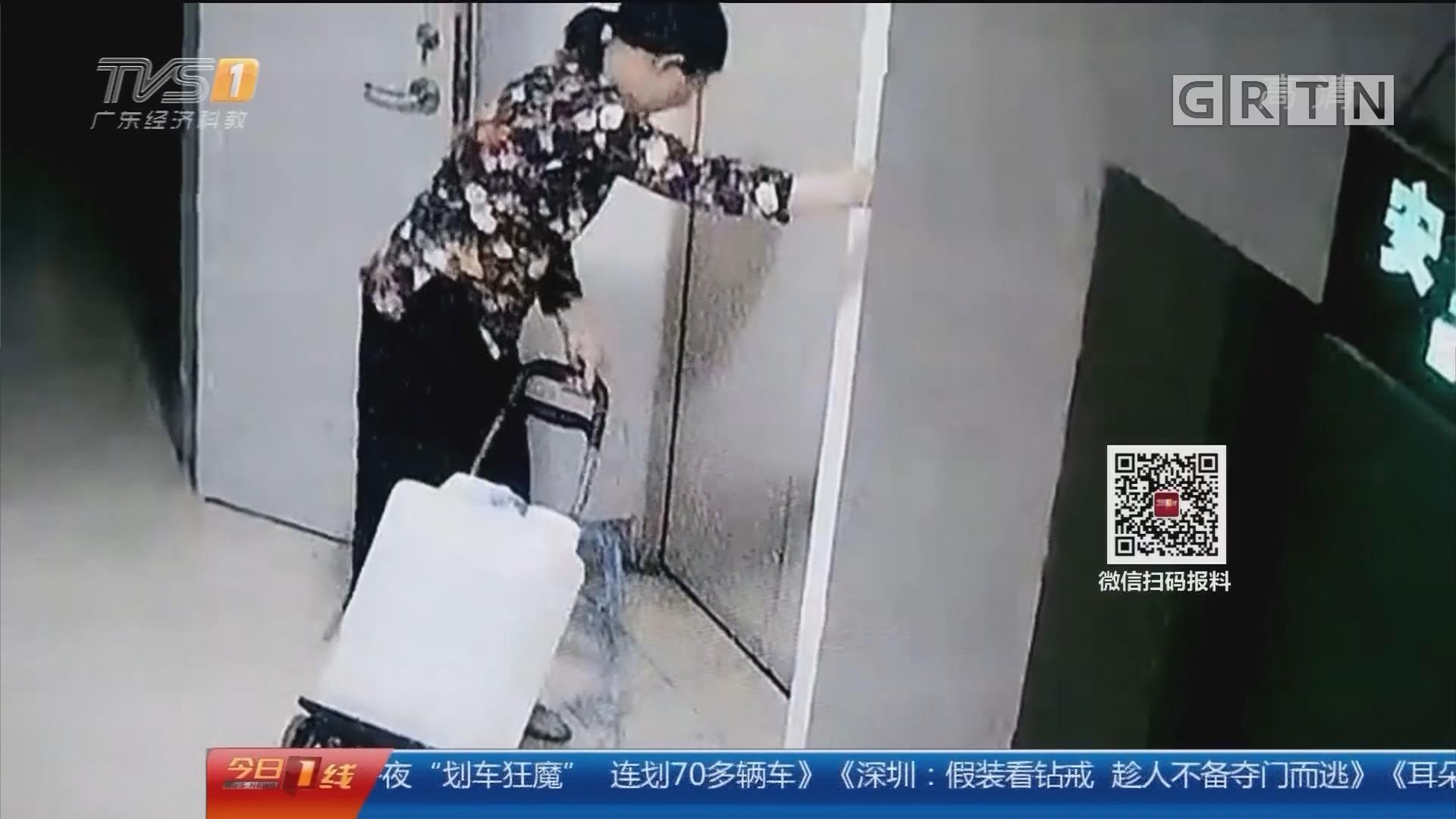 """广州:挂钩卡在电梯槽 一车水桶被""""带飞"""""""