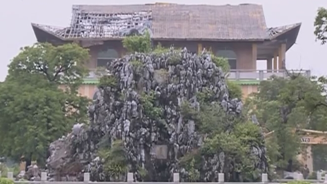 街坊报料:中山绿博园 假山内藏一万支酒